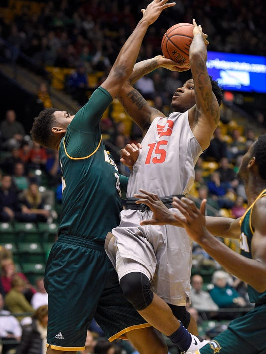 Dayton guard John Crosby (15) goes to the basket against George Mason forward Jalen Jenkins, left, during the second half of an NCAA college basketball game, Saturday, Feb. 6, 2016, in Fairfax, Va. Jenkins was called for a foul on the play. Dayton won 98-64. (AP Photo/Nick Wass)