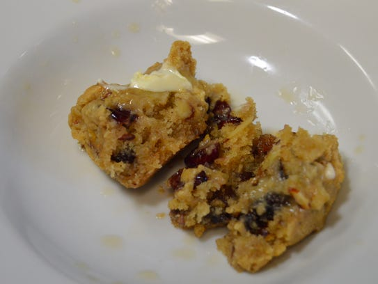 A warm fruitcake muffin topped with margarine and rum,
