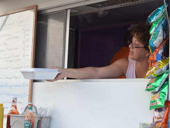Susan Pedergnana of Maxie's Grill hands a customer