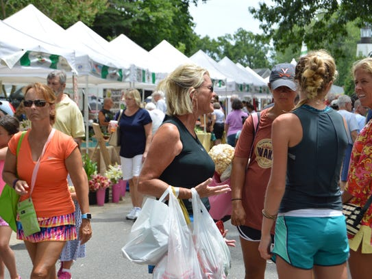 Hundreds gathered Tuesday at the Rehoboth Beach Farmers