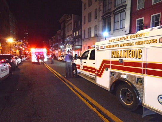 Medics respond to an accidental shooting on Market Street in Wilmington in January.