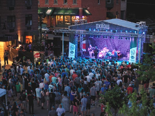 Milwaukee Band Field Report performs outside the Oxbow