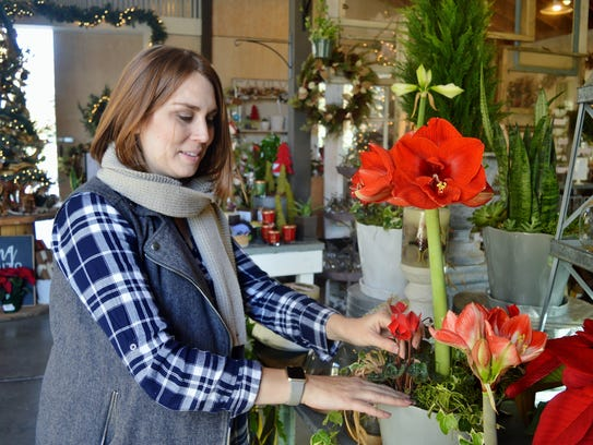 Devon Brown, manager of The Gardens in Tulare rearranges