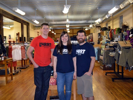 The owners of Roads Rivers and Trails in downtown Milford,