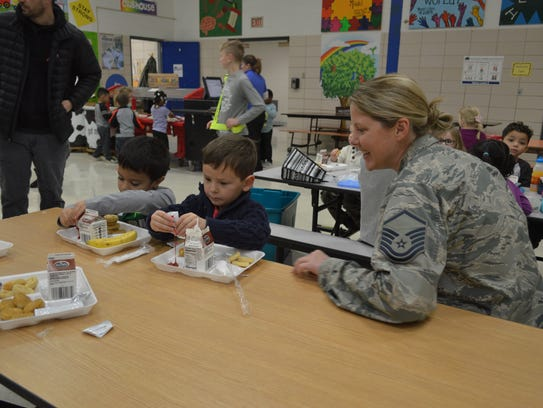 While some servicemen and women were serving lunch,