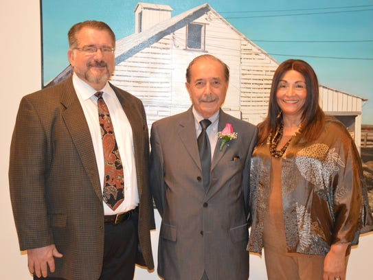 David Moshier, left, with Dr. Walter and Lalita Janke.