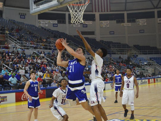 St. Mary's senior Aaron Howell (21) goes for 2 against