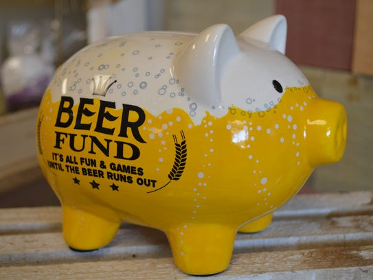 """This """"beer fund"""" piggy bank is $17.99 at Krickette's"""
