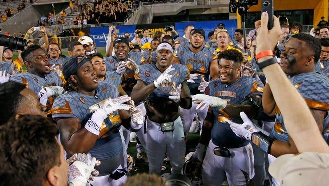 Arizona State players celebrate beating UCLA on Saturday, Oct. 8, 2016, in Tempe, Ariz.  Arizona State defeated UCLA 23-20.