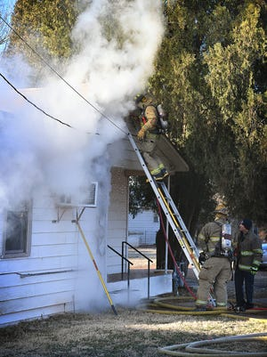 Wichita Falls firefighters work to contain a fire in a home in the 1100 block of Hawthorne Avenue Wednesday morning. The fire was electrical in nature and no injuries were reported.