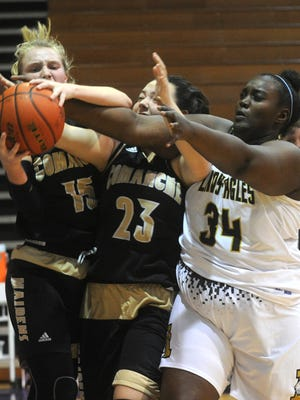 Abilene High's Marvella Inamuco (34) tries to get the ball from Comanche's Macey Brawley (23) and Molly Stephens (15) in a 82-37 win for the Eagles in the Polk-Key City basketball tournament Thursday, Nov. 17, 2016, at HSU.