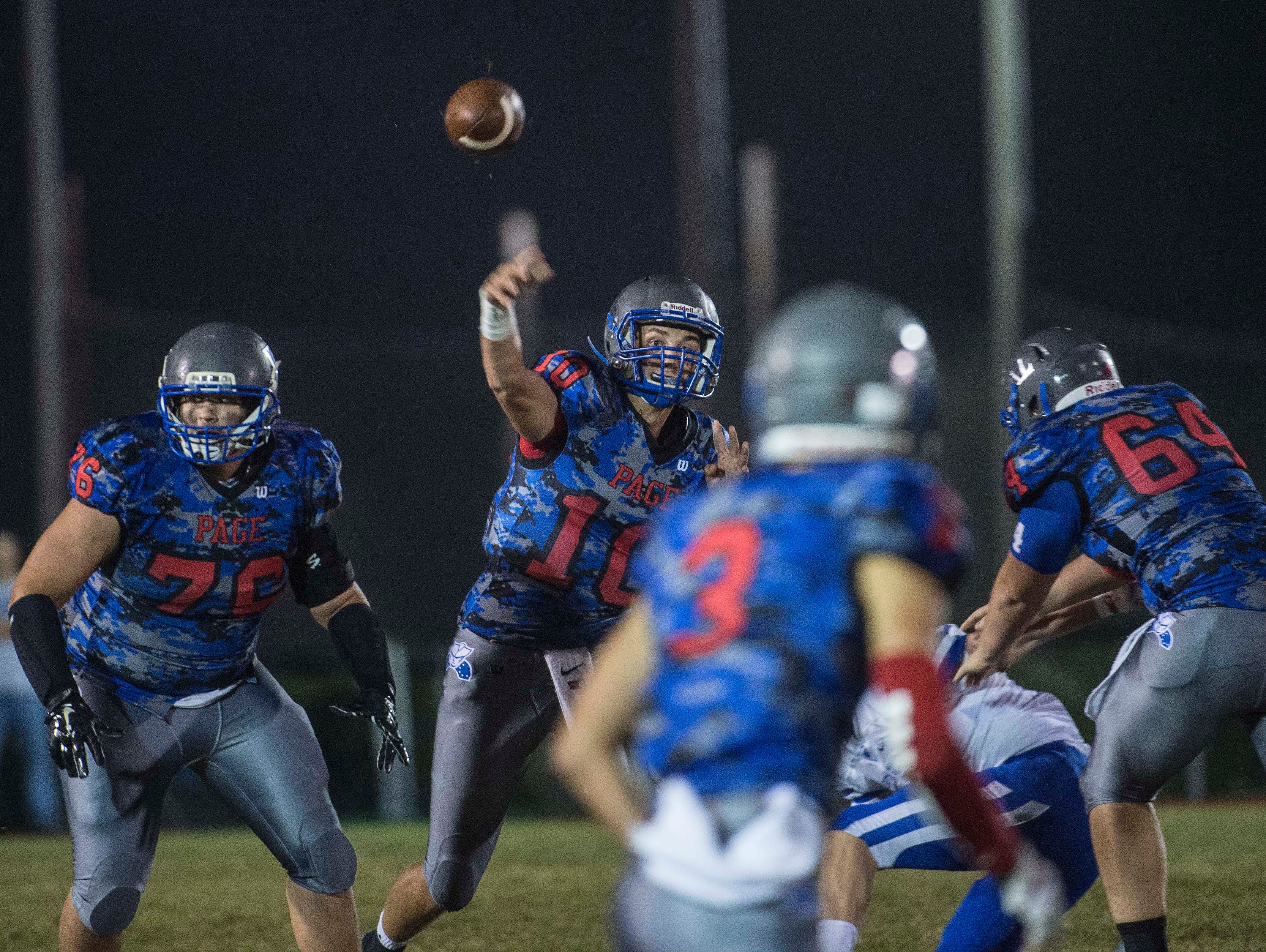 Page quarterback Michael Magochy throw for a touchdown at Page High School on Saturday Sept. 26, 2015, in Franklin in Tenn.