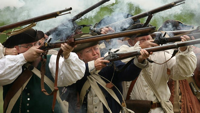 In this file photo, the infantry fires a round during the Morristown National Historical Park's Revolutionary War Encampment at Jockey Hollow.