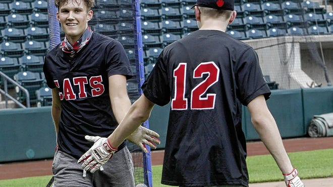Westerville South's Keyton Kowalski (left) slaps hands with teammate Luke Spiller as he leaves the batter's box at Huntington Park on June 30. The Clippers provided a chance for area baseball and softball players from the class of 2020 to have a few more at-bats with their high school teammates after their final seasons were canceled because of the COVID-19 coronavirus pandemic.