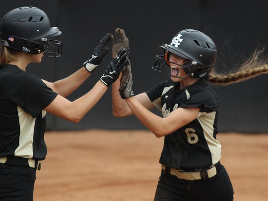 Archer City's Maeley Herring (6) celebrates with teammate Eliot Hilbers after scoring the Lady Wildcats' only run against Bells in a 3-1 loss in the Class 2A semifinals. She scored on a base hit by Audry Lopez, who had three hits.