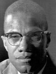 Malcolm X, shown in a photo taken March 5, 1964