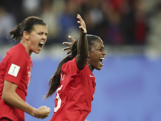 Canada's Nichelle Prince, right, celebrates after scoring her side's second goal in 2-0 win over New Zealand on Saturday.