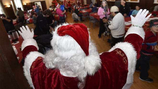 """Santa makes his grand entrance in Ephraim Village Hall during last year's """"Christmas In the Village"""" celebration."""