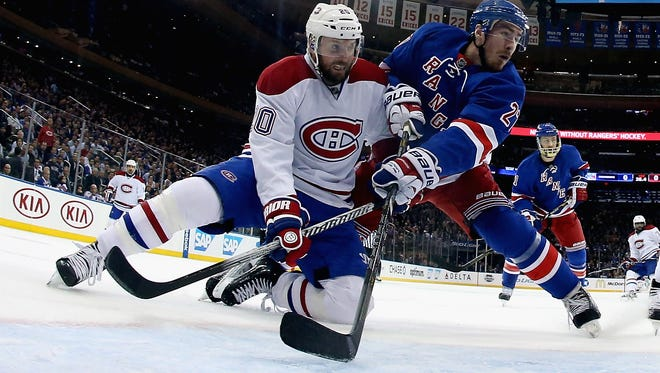 Thomas Vanek of the Montreal Canadiens and Ryan McDonagh of the Rangers battle for position during Game 6 of the Eastern Conference final at Madison Square Garden on May 29, 2014.