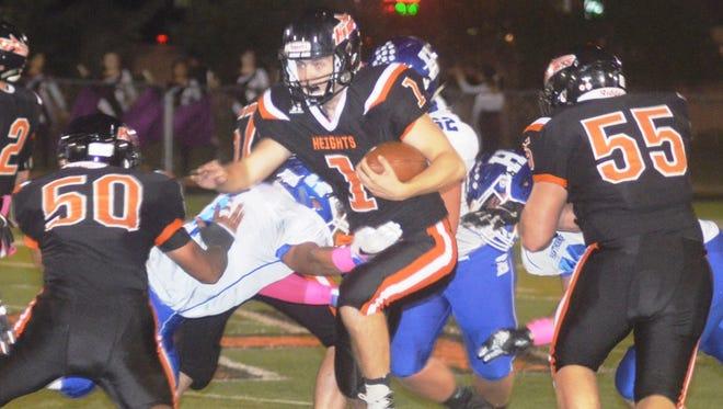 Hasbrouck Heights quarterback James Klenk (1) running through the Hawthorne defense.