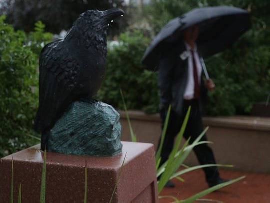 Water drips off a sculpture of a raven Thursday on a corner of The 400 Block in downtown Wausau. The sculpture is by Appleton artist, Charlotte Darling-Diehl, and was put up in time for Wausau's Artrageous Weekend.