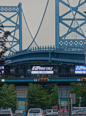 Jose F. Moreno/Courier-PostThe Ben Franklin Bridge's $5 toll will be discounted for frequent users by $1 per round trip, likely by Nov. 1 or Dec. 1. Ben Franklin Bridge five dollar toll.