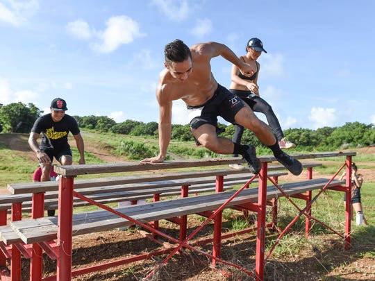"In this file photo, competitors hop off the ""step it up"" obstacle during the Trench Mudder at the Guam International Raceway in Yigo. TRENCH Challenge 2017 is set for Aug. 13."