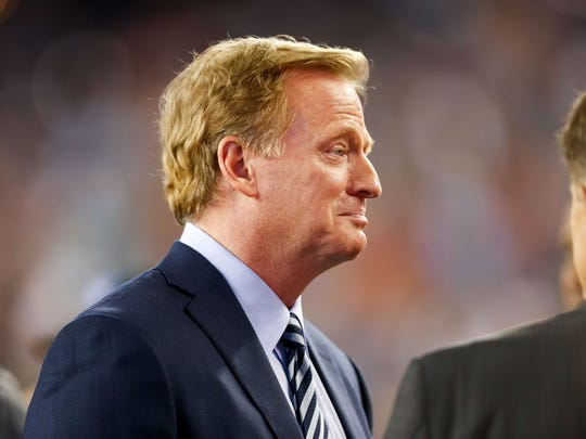 NFL commissioner Roger Goodell talks on the sideline before a game between the New England Patriots and the Kansas City Chiefs at Gillette Stadium.
