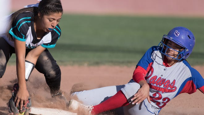 Oñate's Alyssa Reyes takes the throw at second as Las Cruces High's Mariah Hernandez slides in during Friday's District 3-6A matchup at the Field of Dreams Softball Complex.