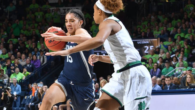 UConn's Gabby Williams, a Reed High graduate, dribbles takes on a Notre Dame defender.