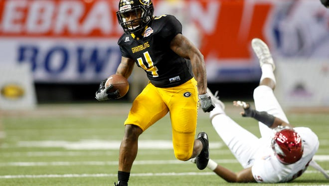 Grambling State Tigers running back Martez Carter (4) runs the ball against the North Carolina Central Eagles in the second quarter at the Georgia Dome. Mandatory Credit: Brett Davis-USA TODAY Sports