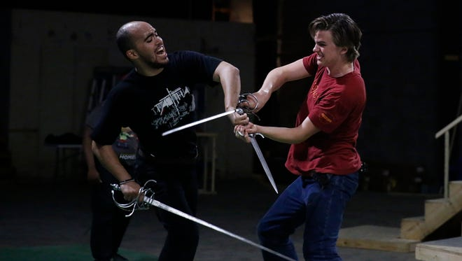 Michael Nichols, left, and Miles Muir practice their swordplay during rehearsals Wednesday, April 18, 2018 for the Southern Shakespeare Company's upcoming production of Romeo & Juliet.