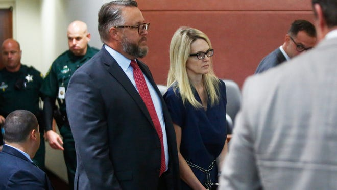 Denise Williams, right, walks emotionless into Courtroom 3A with her defense lawyer, Ethan Way, left, at the Leon County Courthouse on Monday. Williams is charged with the murder of her former husband, Mike, who went missing in December of 2000.