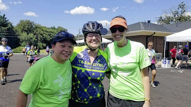 Julia Duncan (center) of Canal Winchester is pictured with Emily Dotson (left) and Gai Mei Wong at a rest stop during last year's race.