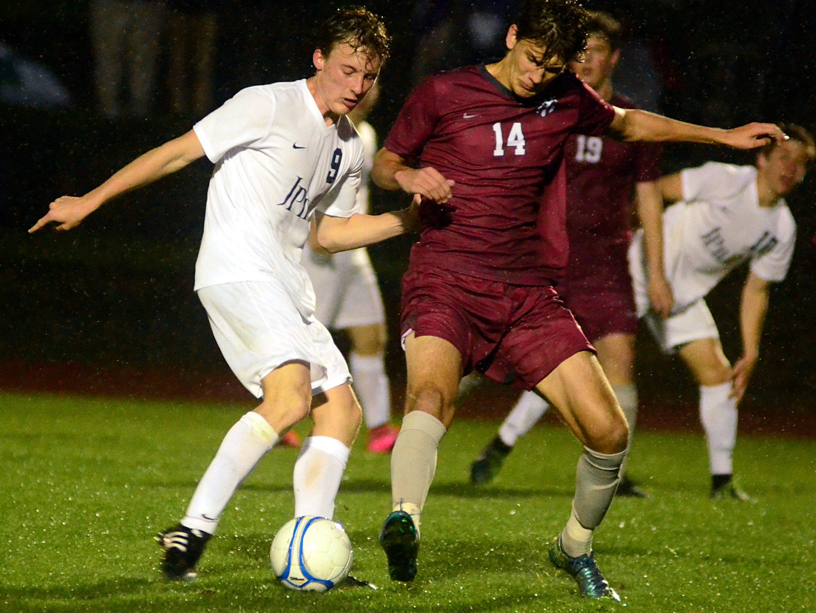 Pope John Paul II High senior Andrew Harrison battles for possession with Montgomery Bell Academy senior Will Emerson during second-half action.