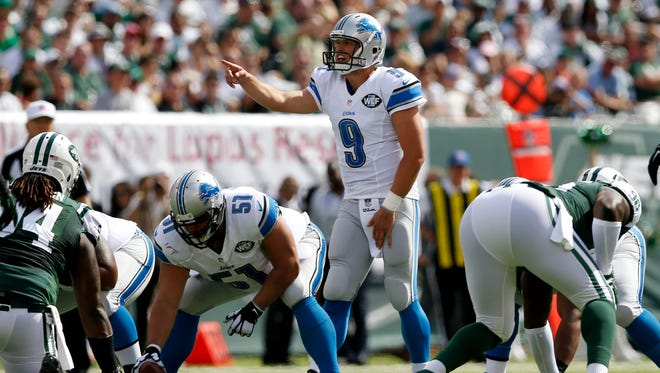 Detroit Lions quarterback Matthew Stafford (9) talks to his team before the snap against the New York Jets on Sunday, Sept. 28, 2014, in East Rutherford, N.J.