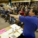 Precinct chairman Keith Lowe guides participants at a January 2004 caucus at the Johnston High School library. A bill requiring employers to give time off to non-essential workers so they can attend Iowa's presidential caucuses received preliminary approval in the Iowa Senate on Tuesday.