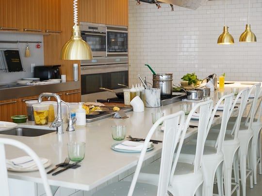 The kitchen and communal table at Heirloom Kitchen in Old Bridge.