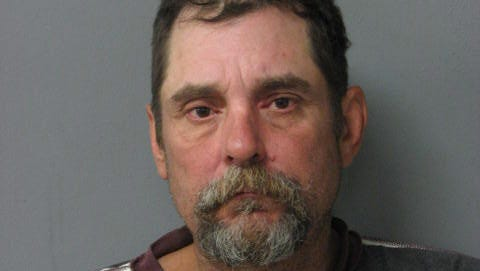 Louis Vedrine was arrested Sunday for soliciting donations by holding up a Mother's Day sign.