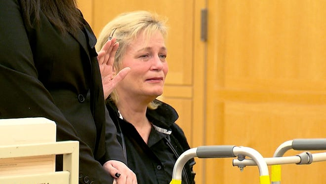 Kathy Dymes appears in the Westchester County Courthouse in White Plains on Jan. 19, 2016, pleading guilty to criminally negligent homicide in the death of her 6-year-old daughter, Lacey Carr.