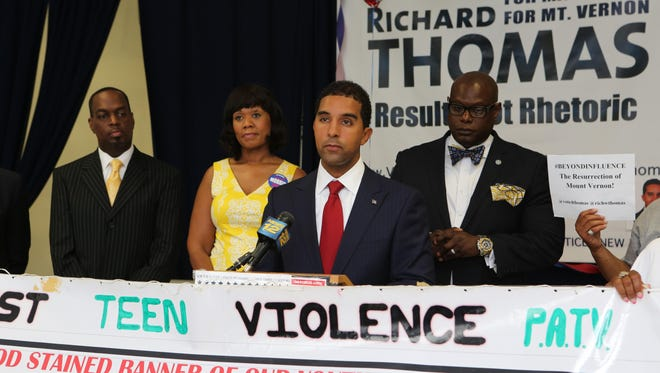 Richard Thomas, a Democratic candidate for Mount Vernon mayor, holds an anti-gun violence rally at his campaign headquarters in Mount Vernon Saturday.