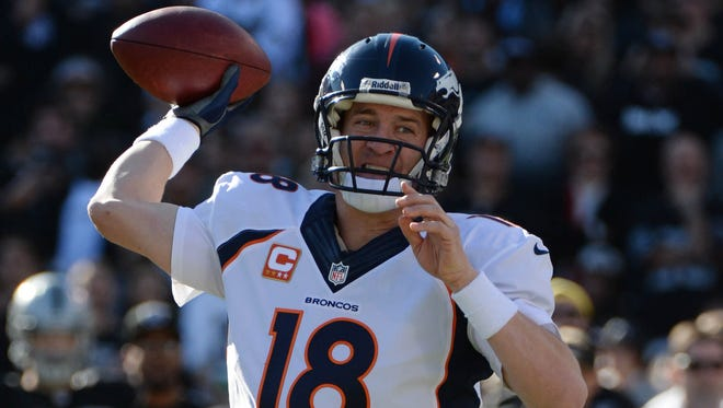 Broncos QB Peyton Manning broke single-season NFL records for passing TDs and yards the past two weeks.