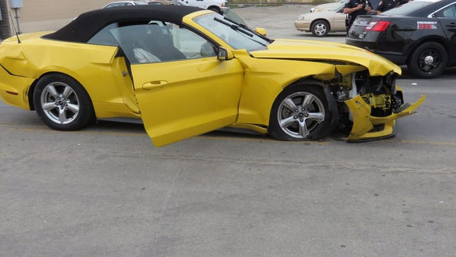 A man crashed this Mustang into another car while fleeing police.
