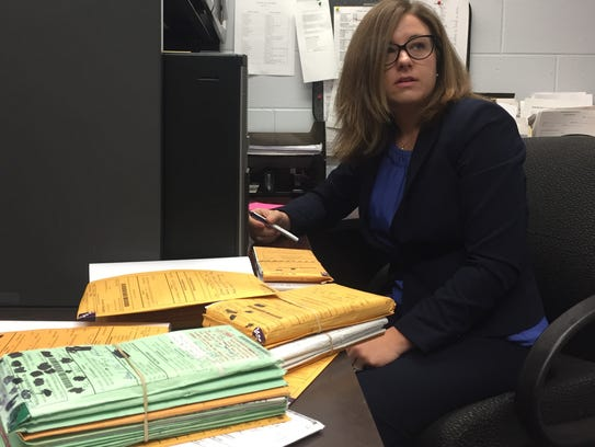 Assistant County Attorney Amelia Aslam evaluates cases