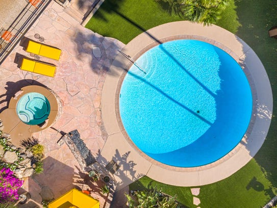 A perfectly round pool at the Alexander house, a midcentury