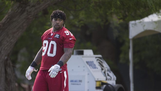 Cardinals' Robert Nkemdiche (90) runs a drill during OTAs at the Cardinals Training Facility in Tempe, Ariz. on June 1, 2017.