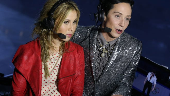 Figure skating champions Johnny Weir and Tara Lipinski comment for NBC the Figure Skating Men's Free Skating on day seven of the Sochi 2014 Winter Olympics at Iceberg Skating Palace  on February 14, 2014 in Sochi, Russia.