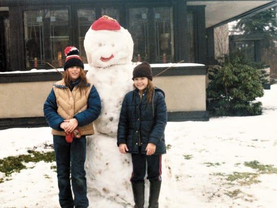 Kim Bixler and her brother outside the Boynton House.