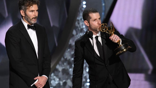 David Benioff (l) and D.B. Weiss accept award for Outstanding Writing For A Drama Series for  'Game of Thrones' during 68th Emmy Awards, Sept. 18, 2016.