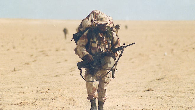 A soldier treks across the desert during the Gulf War in 1991.